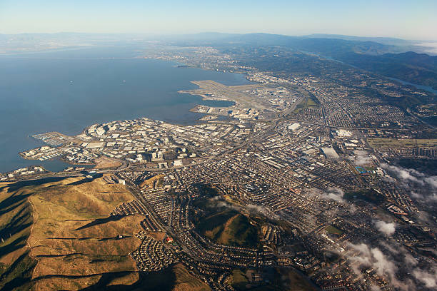 SFO and South San Francisco Aerial view of San Francisco International Airport, SFO, San Francisco Bay, and South San Francisco san francisco bay stock pictures, royalty-free photos & images