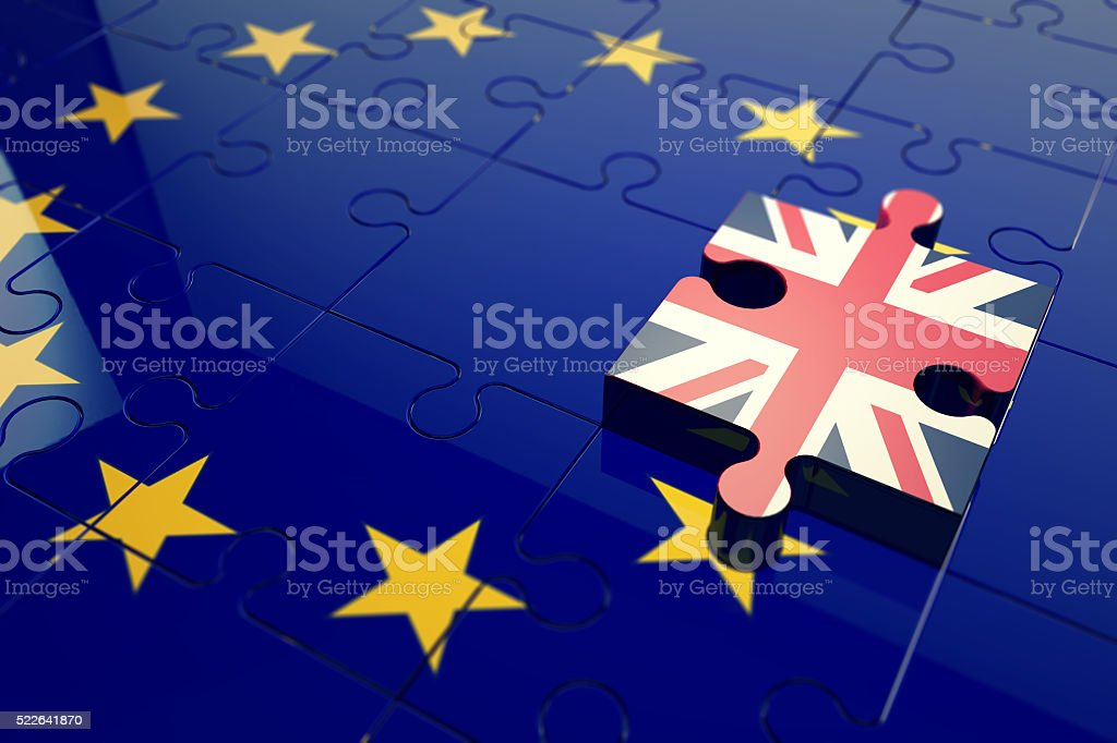 EU and UK flag puzzle pieces stock photo