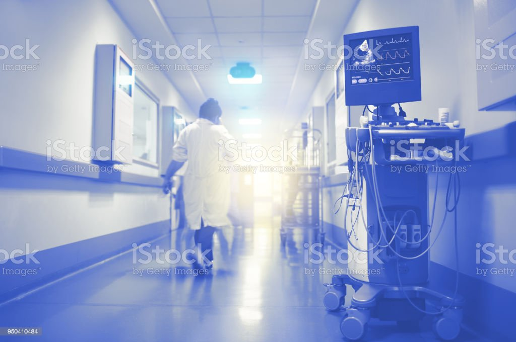 ECG and ultrasonic monitoring of cardiac function with flashing light in the end of hospital hallway stock photo