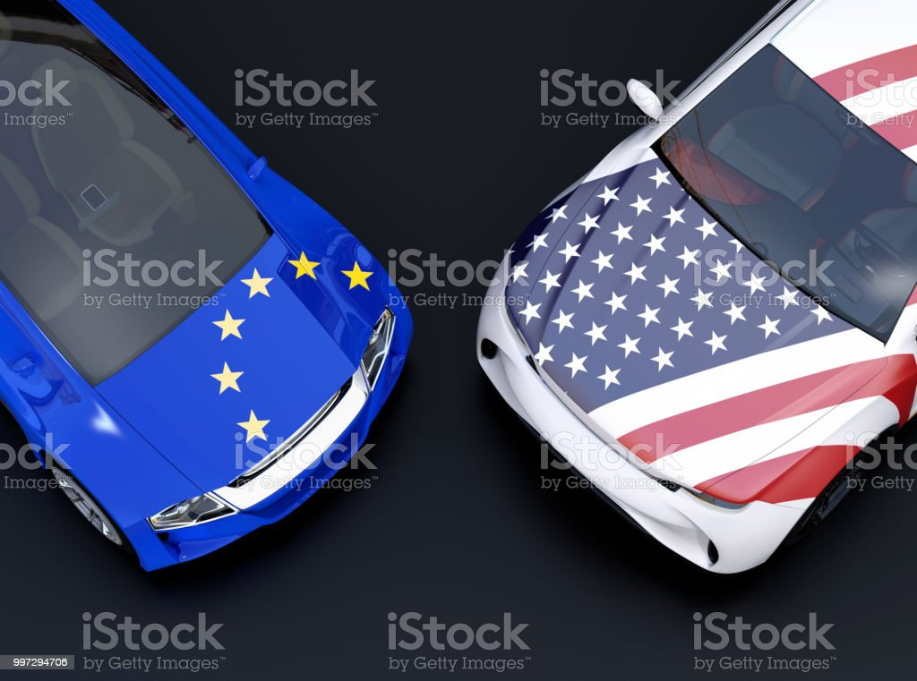 EU and US flags on two automobiles hood. black background stock photo
