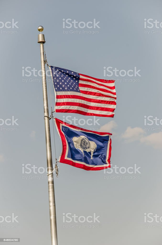 US and Wyoming Flags stock photo