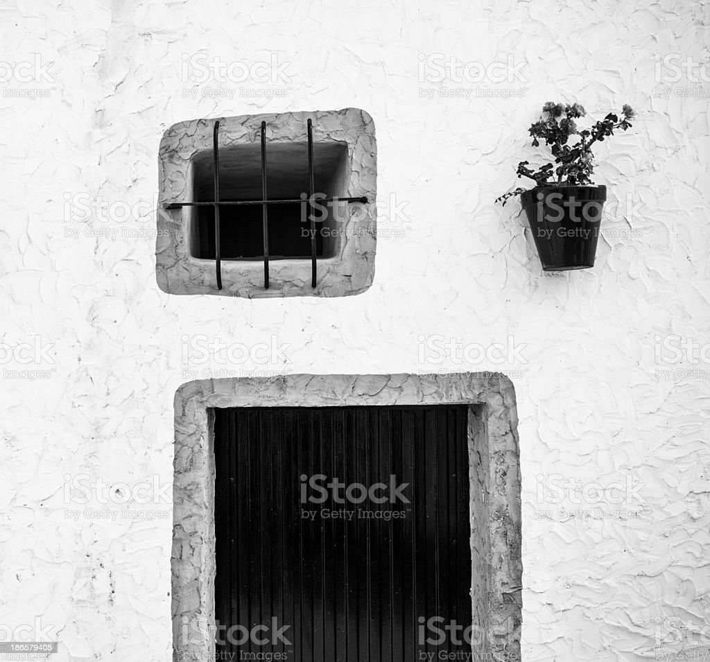 Andalusia: geranium hanging on wall royalty-free stock photo