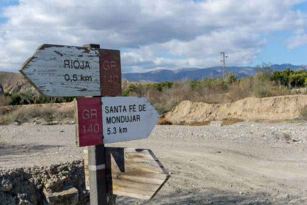 Andalusian landscape around Almeria with road signs in a dry river, idyllic mountains, Spain on a day in spring stock photo