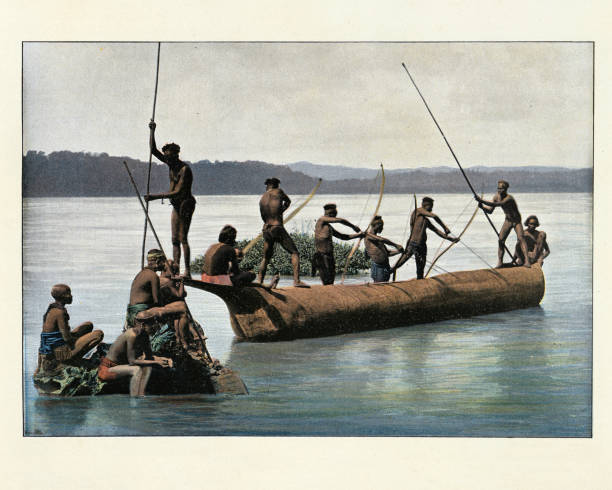 Andamanese tribes fishing with bows, Andaman Islands. Antique colourised photograph stock photo