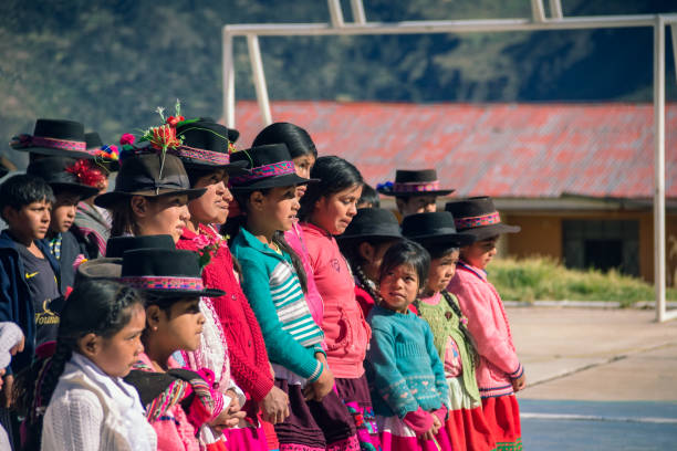 Andean children gathered in the schoolyard stock photo