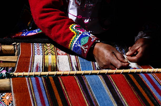 Andean Weaver in Sacred Valley, Cusco, Peru stock photo