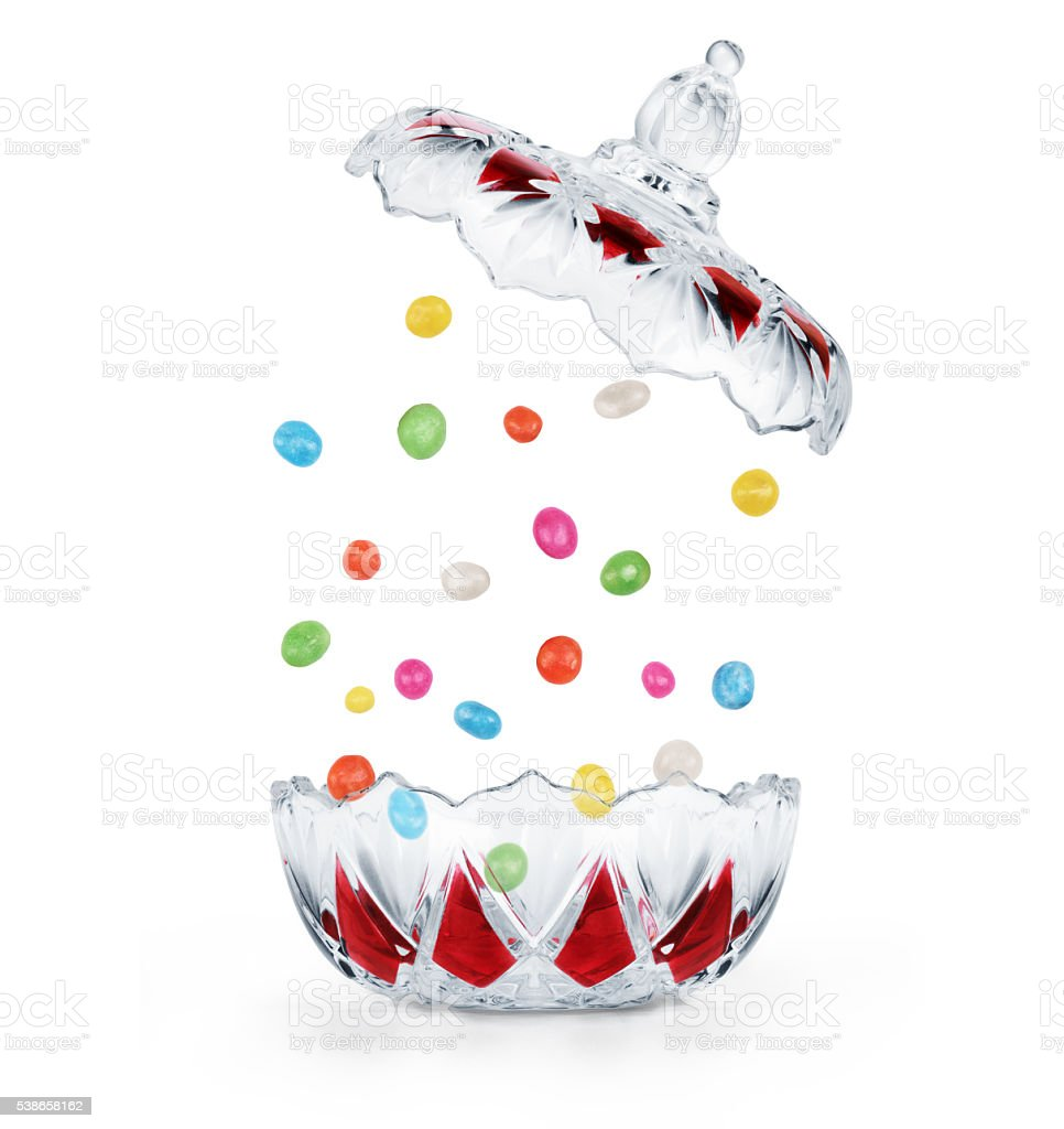 Сandies falling into the clear candy on a white background stock photo