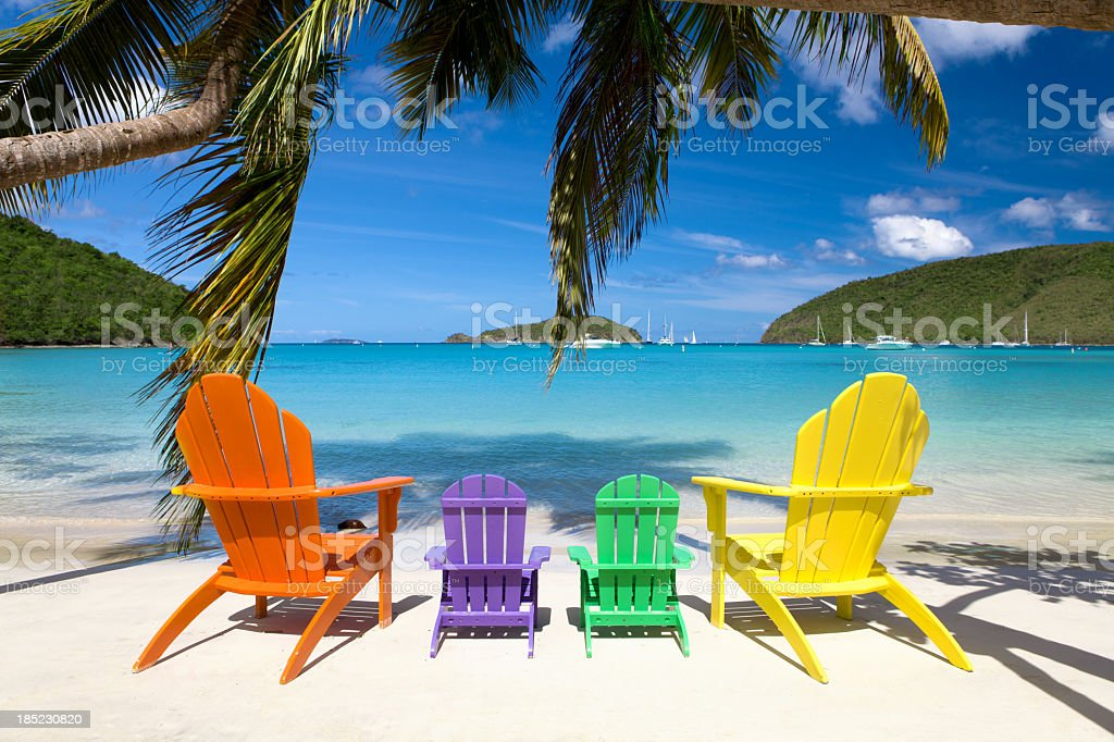 andirondack chairs at a beach in the Caribbean stock photo