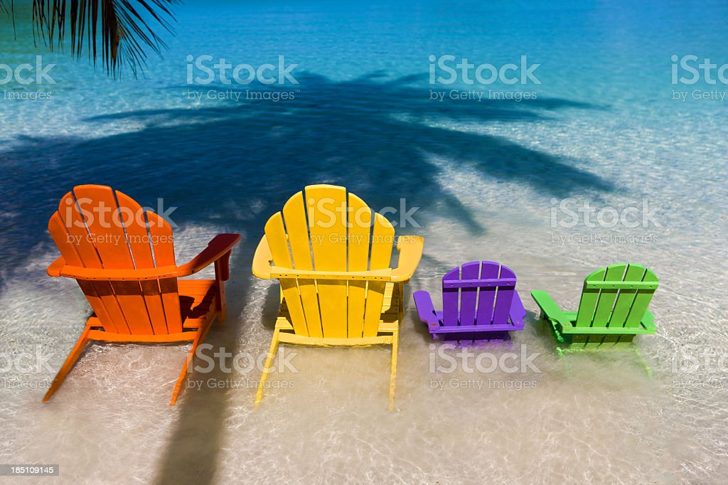 andirondack chairs for family vacation at a Caribbean beach stock photo