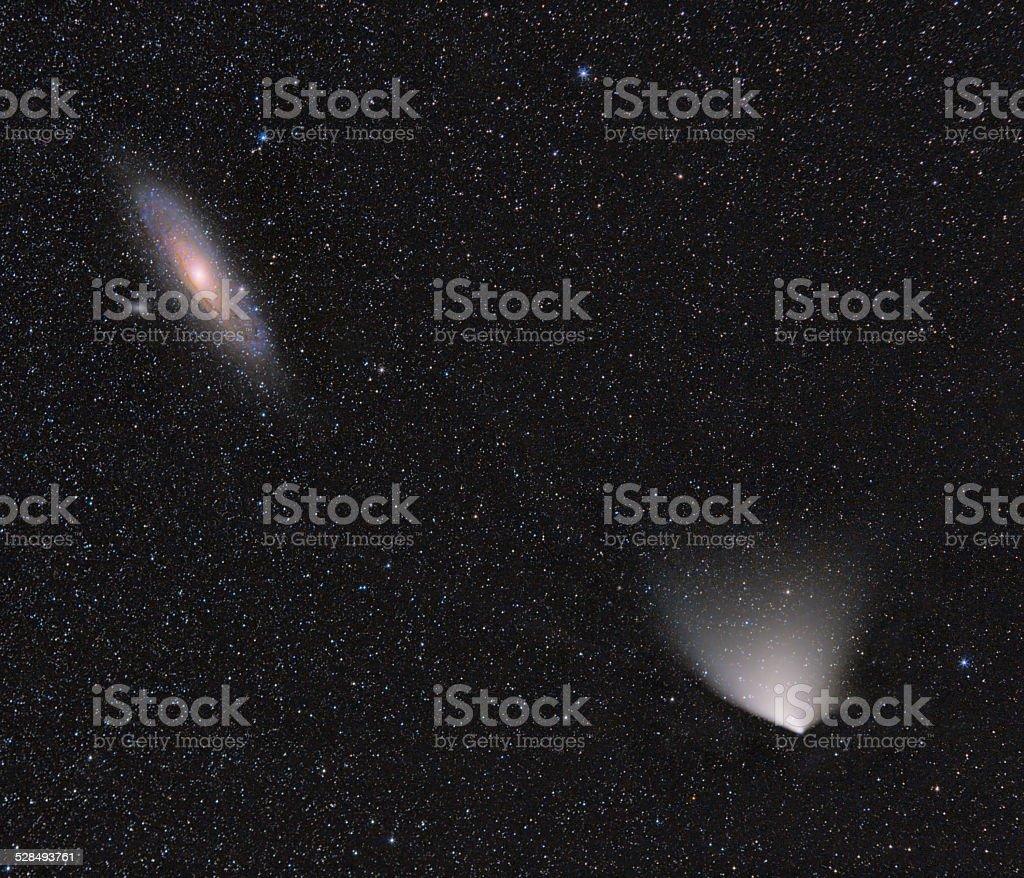 Andormeda Galaxy and comet stock photo