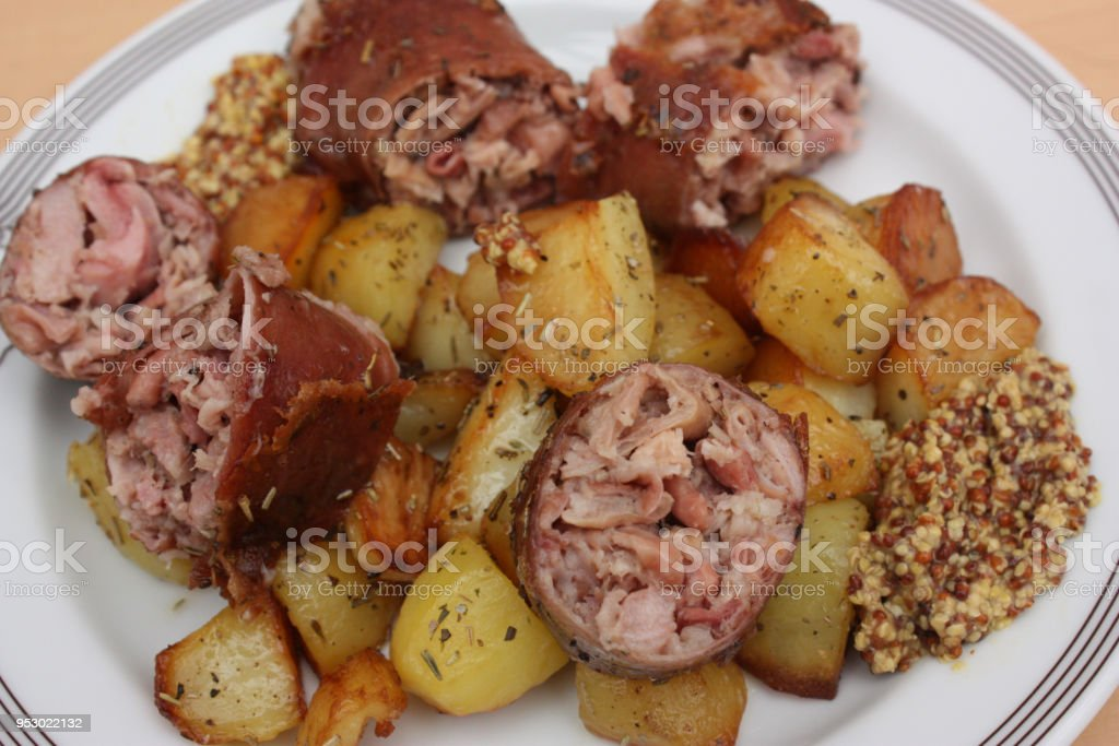 Andouillette Potatoes cooked with garlic stock photo