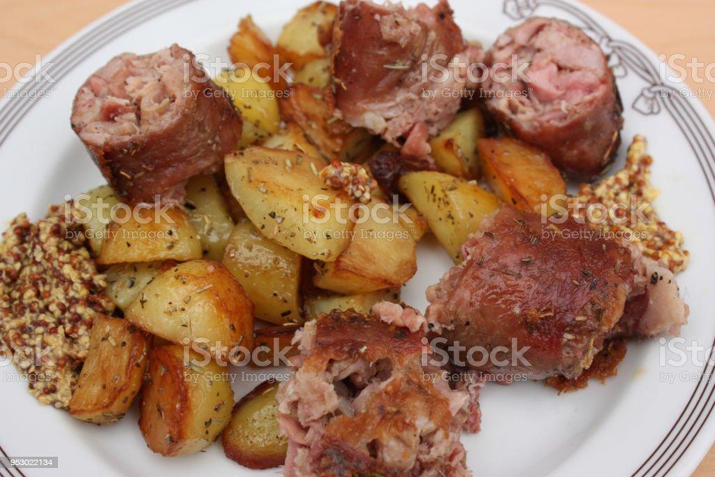 Andouillette pommes de terre cuites à l'ail - Photo
