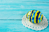Hand-painted yellow Easter egg