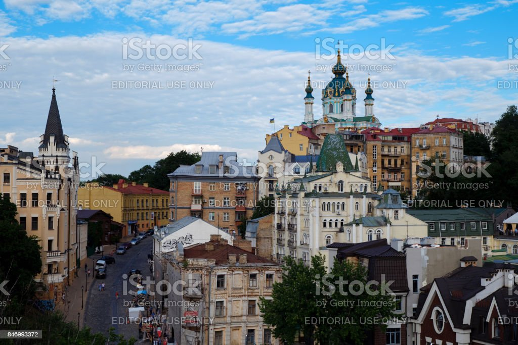Andriyivskyy Descen street with Saint Andrew's Church and Castle of Richard the Lionheart in Kyiv stock photo