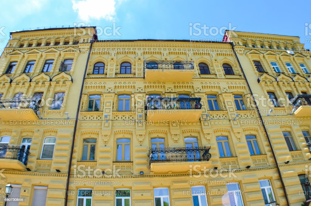 Andriyivskyy Uzvoz Descent or Spusk with yellow building with old architecture and balconies stock photo