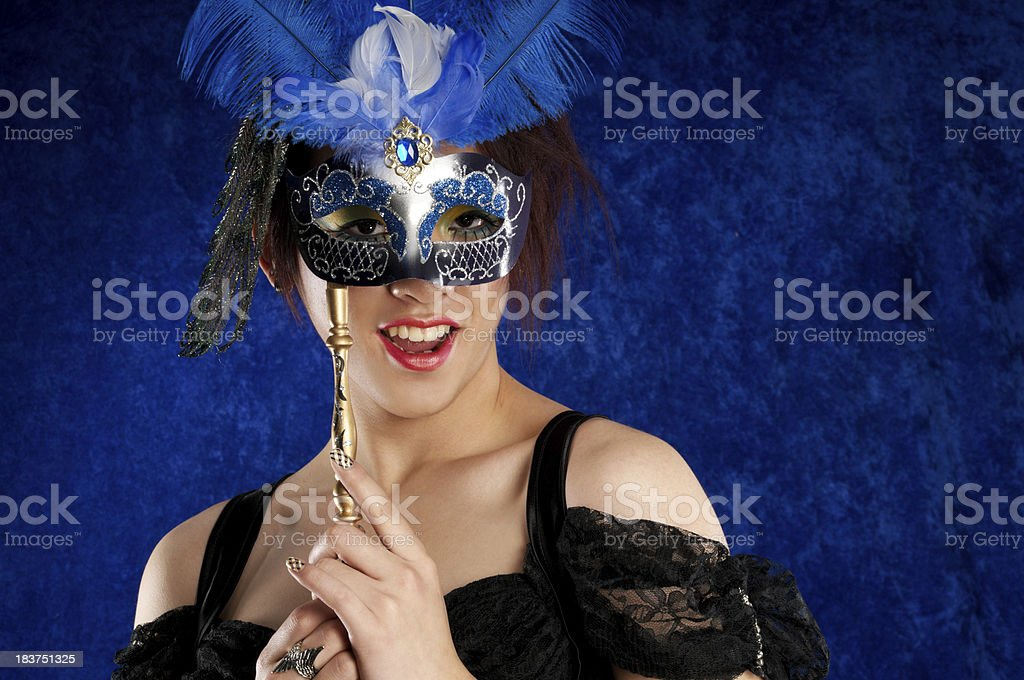 Androgynous Asian male with mask and smile royalty-free stock photo