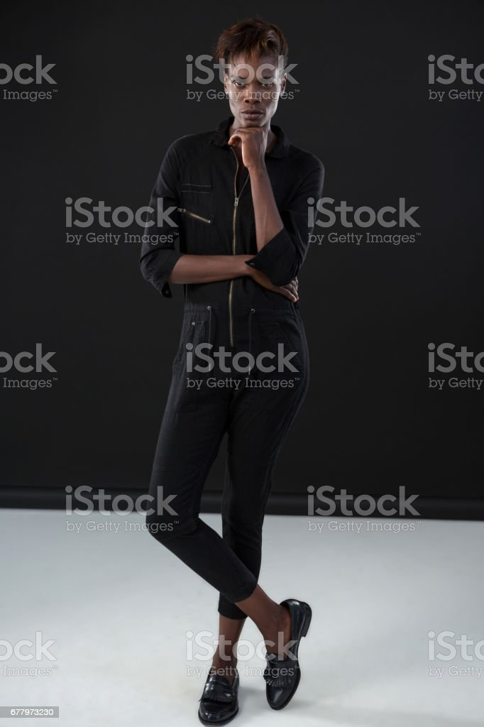 Androgynous man posing with hand on his chin royalty-free stock photo