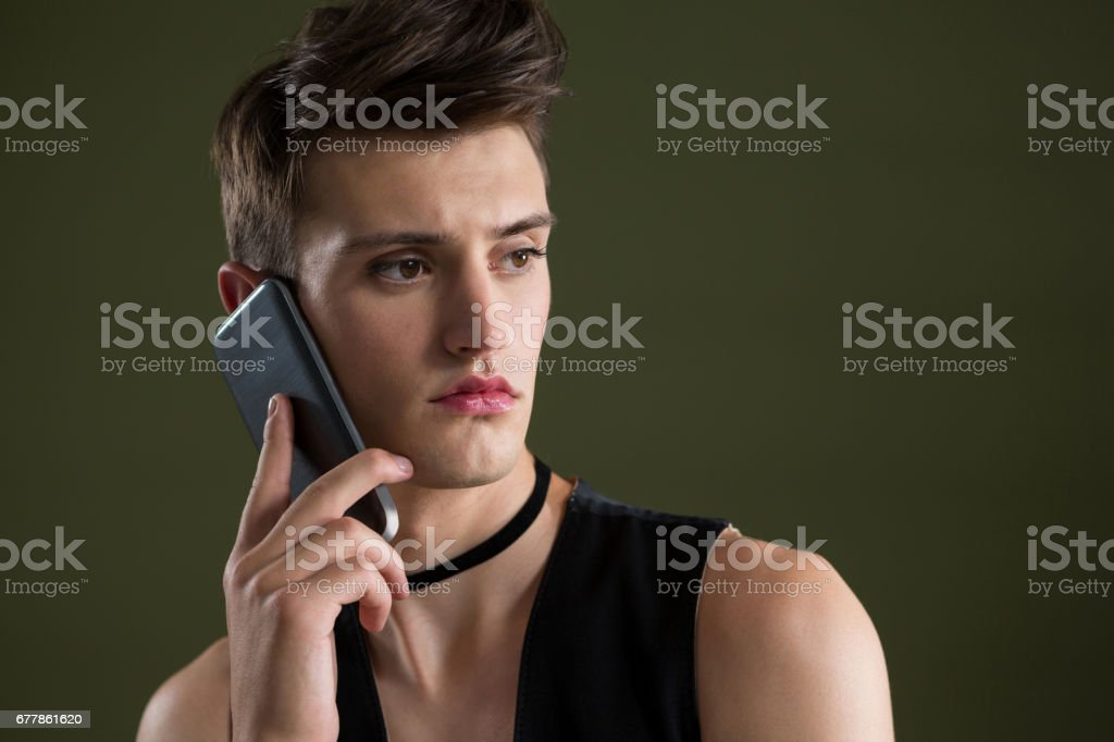 Androgynous man talking on mobile phone royalty-free stock photo