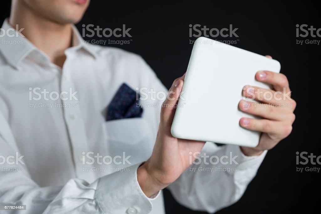 Androgynous man using digital tablet royalty-free stock photo