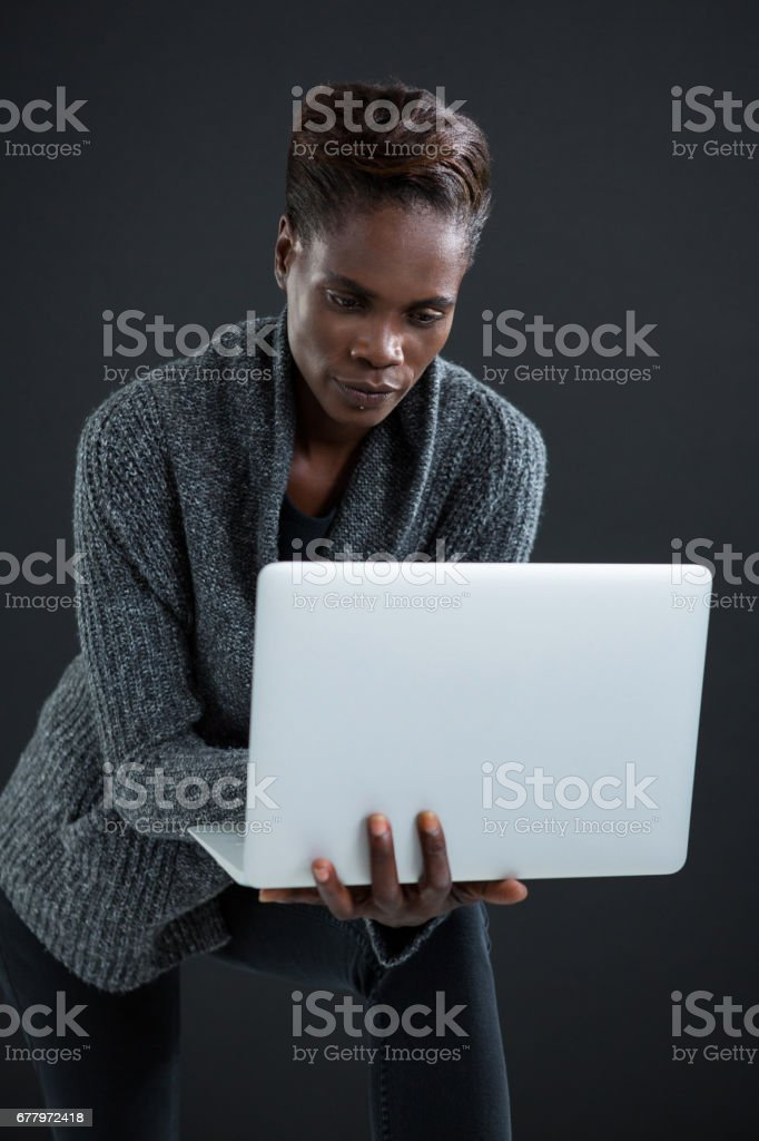 Androgynous man using laptop royalty-free stock photo