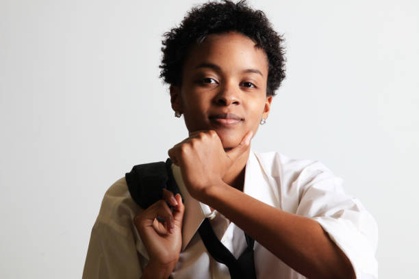 androgynous woman androgynous African ethnicity woman in masculine suit and tie transgender stock pictures, royalty-free photos & images