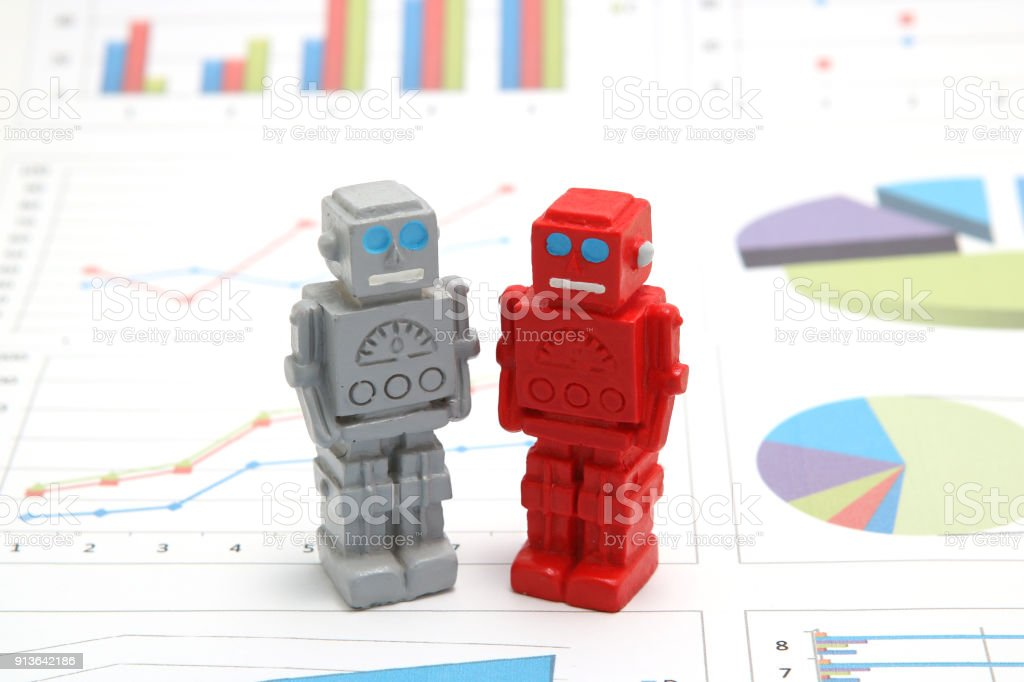 Android robots or artificial intelligence and graphs are written documents on white background. Concept of artificial intelligence. stock photo