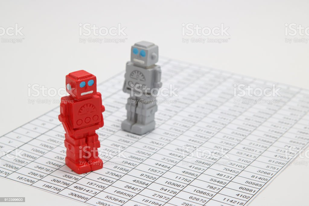 Android robots or artificial intelligence and numbers are written documents on white background. stock photo
