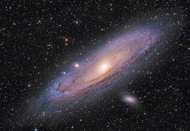 andromeda galaxy - sternhaufen stock-fotos und bilder