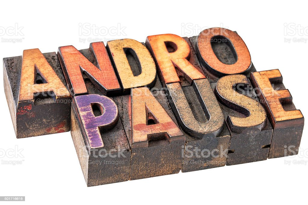 andropause word in wood  type stock photo