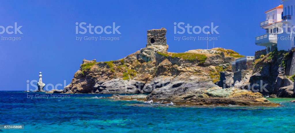 Andros island - panoramic view with ancient tower and light house. Greece, Cyclades stock photo