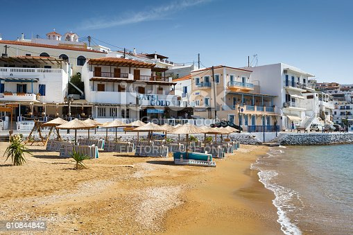 Batsi, Greece - September 19, 2016: Batsi village on the coast of Andros island in Greece. Image shows the seafront of the town next to the  town beach.
