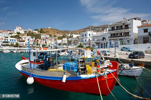 Batsi, Greece - September 19, 2016: Batsi village on the coast of Andros island in Greece. Image shows the seafront of the town in the harbour.
