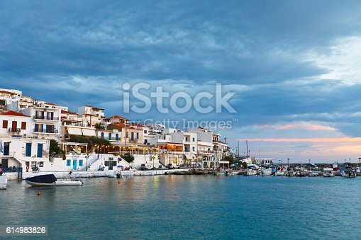 Batsi, Greece - September 19, 2016: Batsi village on the coast of Andros island in Greece. Image shows the seafront of the town in the harbour in the evening.