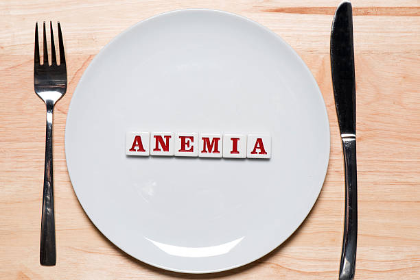 Anemia - healthy eating concept Anemia spelled out on a plate - healthy eating concept - studio shot anemia stock pictures, royalty-free photos & images
