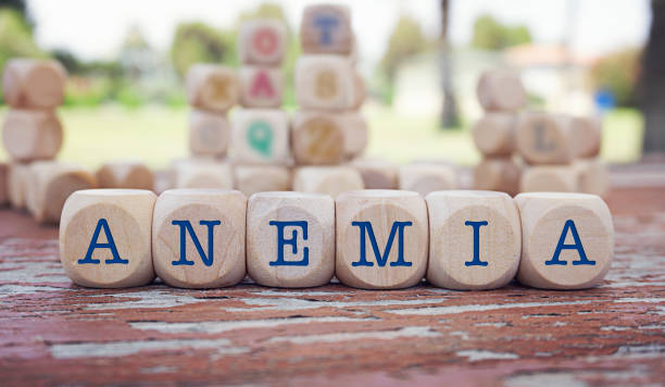 anemia word written on cube shape wooden blocks on wooden table. - anemia foto e immagini stock