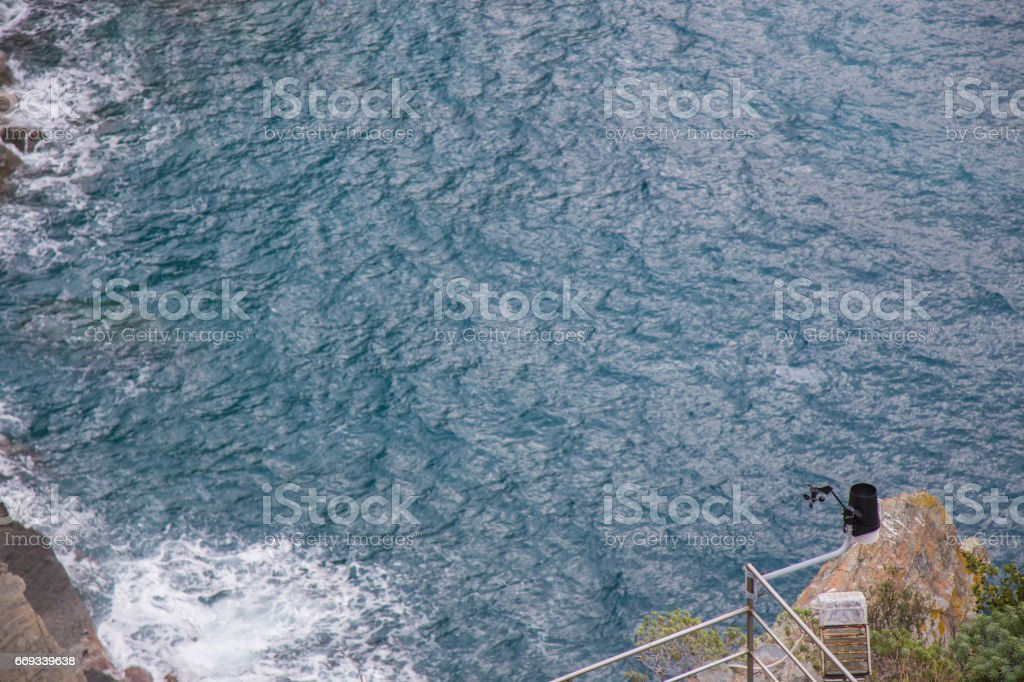 Anemometer and rain gauge on the cliff.In the Five Terre.In Liguria region. stock photo