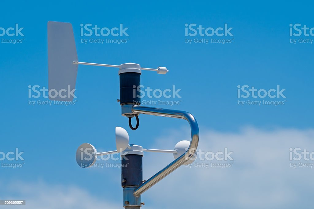 Anemometer, blue sky with clouds as background stock photo