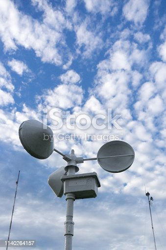 istock Anemometer meteorology tool under the bright blue sky with and altocumulus clouds 1140264157
