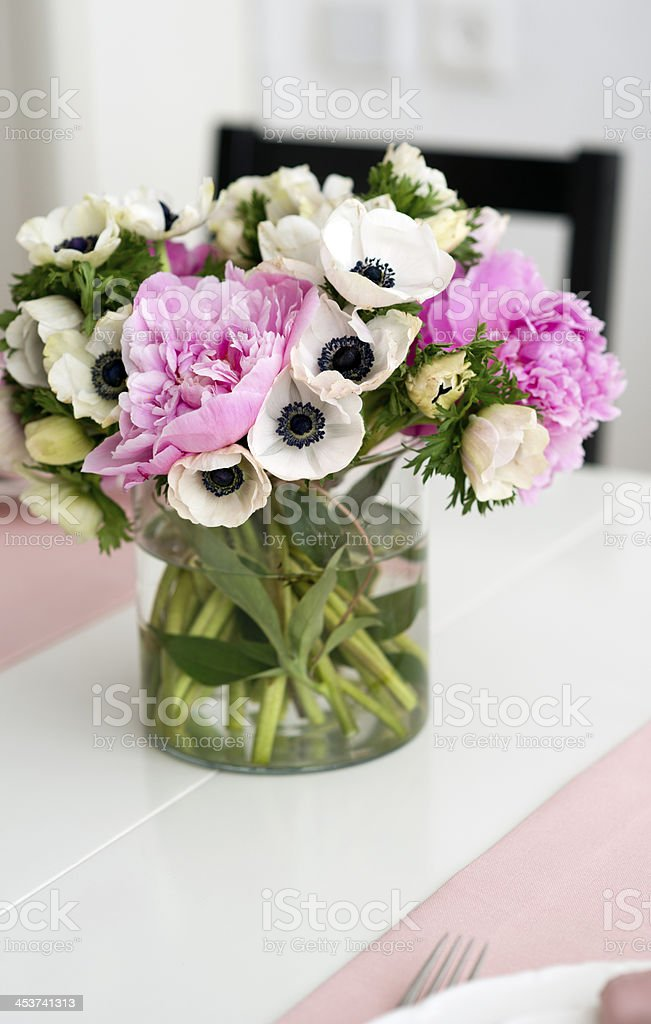 anemone and peony bouquet in a vase royalty-free stock photo