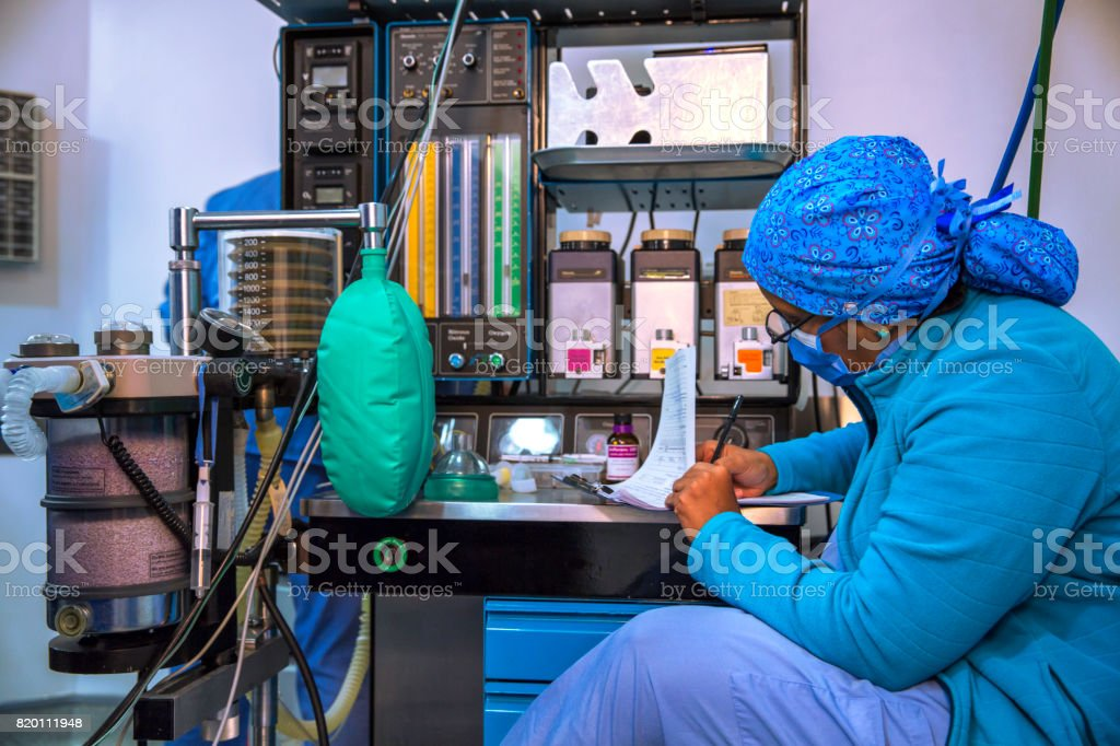 Anesthesiologist working with Anesthesia Machine during surgical procedure. stock photo