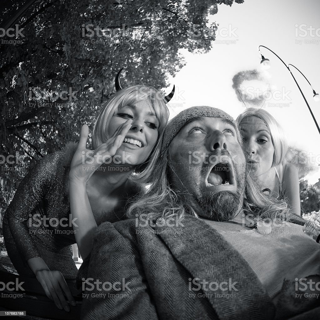 Angel and devil advice to an  Homeless - Opposite Personalities royalty-free stock photo
