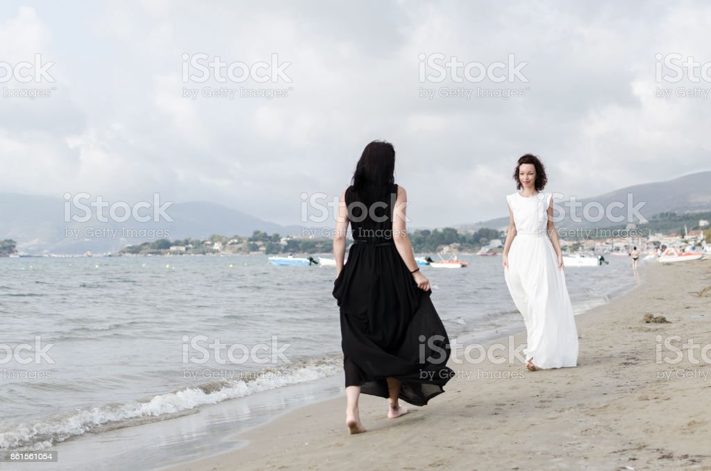 Angel and devil women stock photo