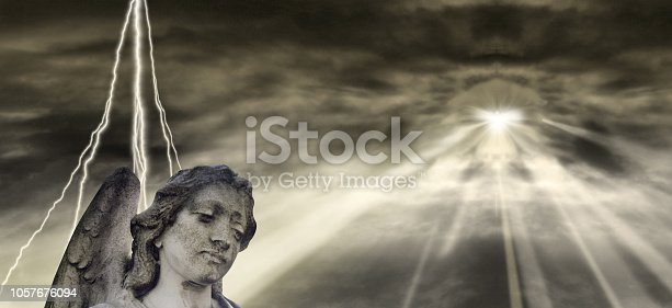 istock Angel and dramatic Sky 1057676094