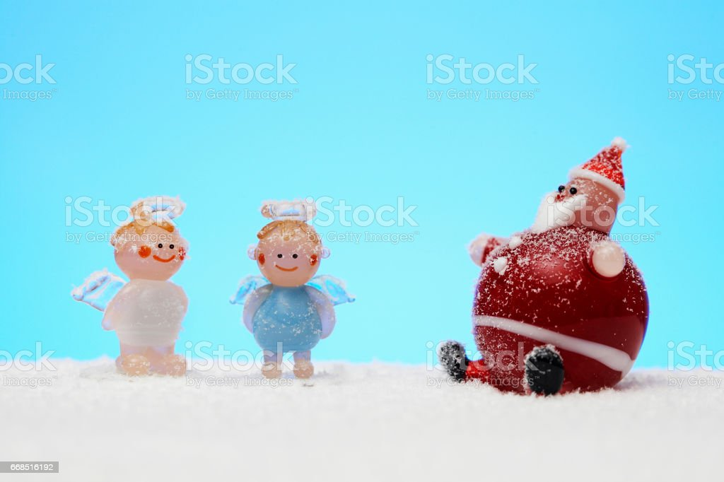 Angel and Santa stock photo
