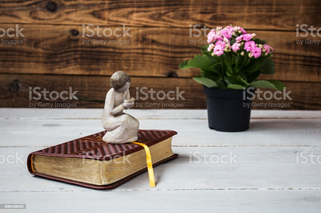 angel and the bible stock photo