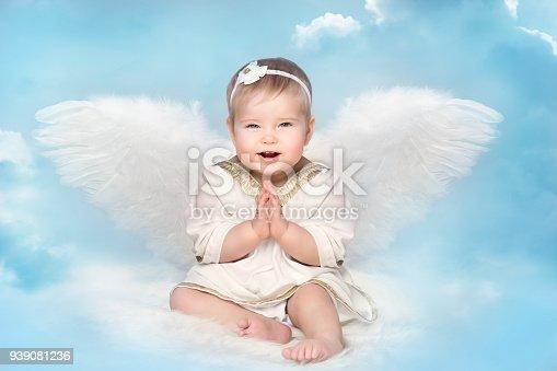 istock Angel Baby Amur Wings, Kid Cupid on Blur Sky, Happy Child Portrait 939081236