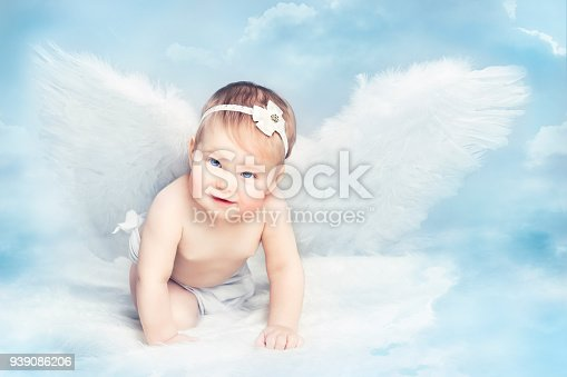 istock Angel Baby with Wings Crawling on Sky, Kid Girl Cupid, Artistic Child Portrait 939086206
