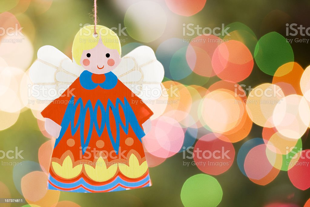 Angel Christmas Ornament with Tree Lights, Copy Space stock photo