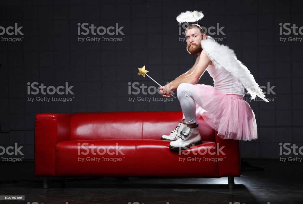 Angel: costume man sitting on couch royalty-free stock photo