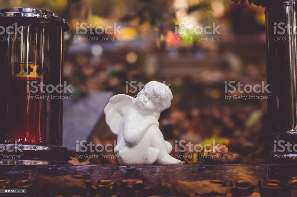 angel decoration during All Saints DAy at the cemetery stock photo